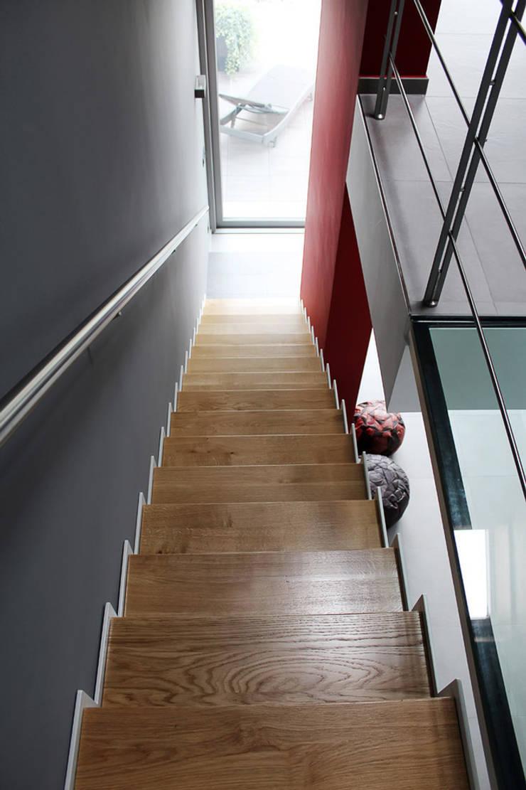 SAN BENIGNO HOUSE: Soggiorno in stile  di Studio 06, Moderno