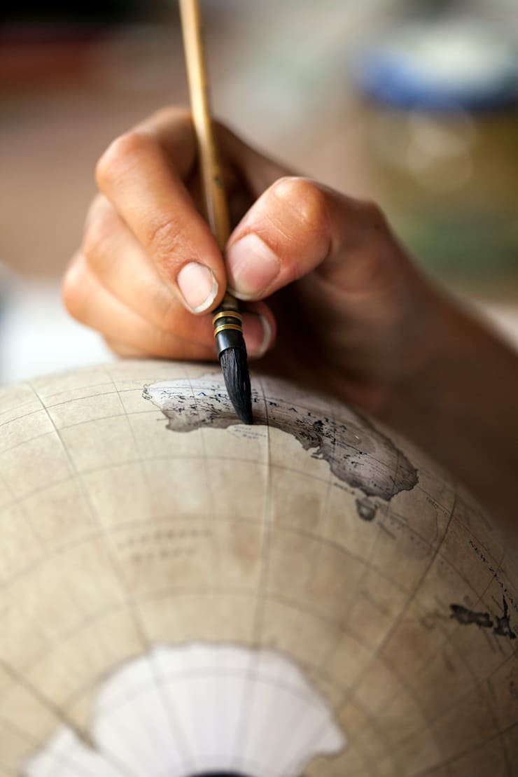 Details being painted on a Mini Desk Globe:   by Bellerby and Co Globemakers