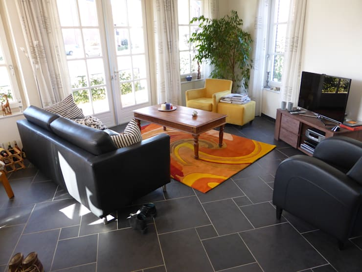 Sala de estar  por Vloerkledenwinkel