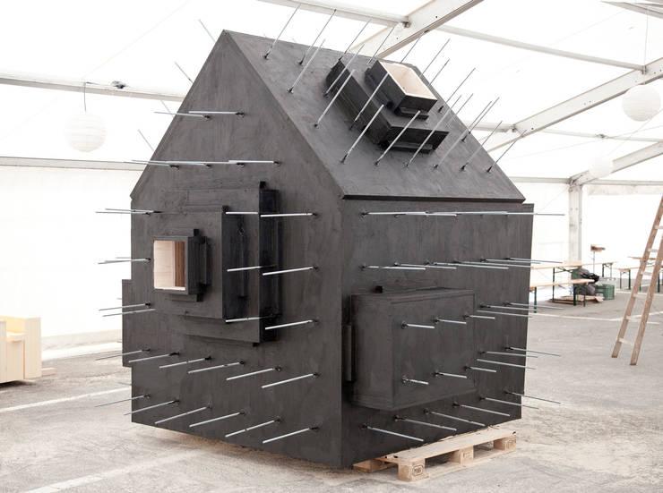 Projekty, minimalistyczne Domy zaprojektowane przez Bureau A