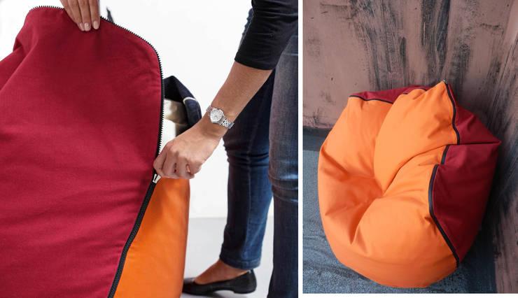 Geometrie in movimento - pouf/armchair CONKA: Soggiorno in stile  di design Inmovimento ,