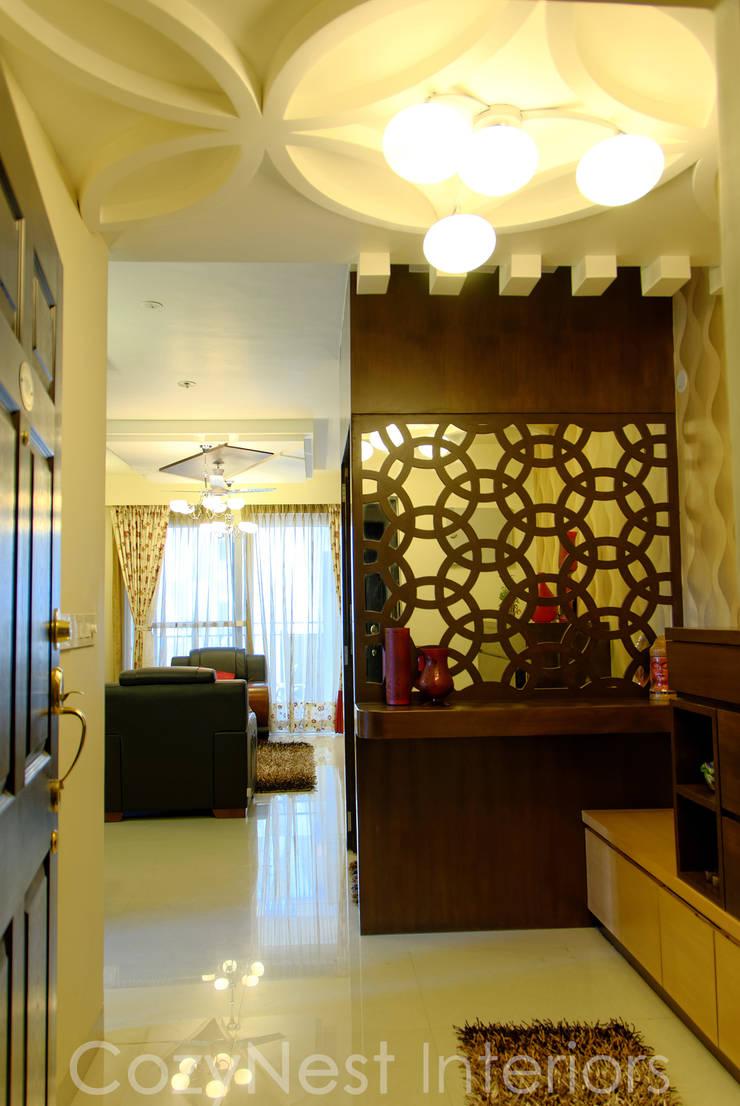Priyanka & Yashbir:  Living room by Cozy Nest Interiors