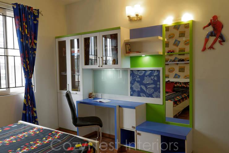 Priyanka & Yashbir:  Nursery/kid's room by Cozy Nest Interiors