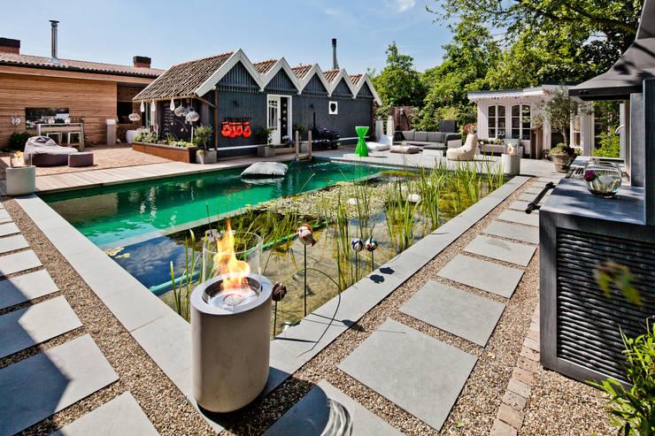 Jar Commerce, Planika : styl , w kategorii Ogród zaprojektowany przez Planika Fires