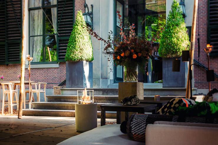 Jar Commerce, Planika : styl , w kategorii Balkon, weranda i taras zaprojektowany przez Planika Fires,