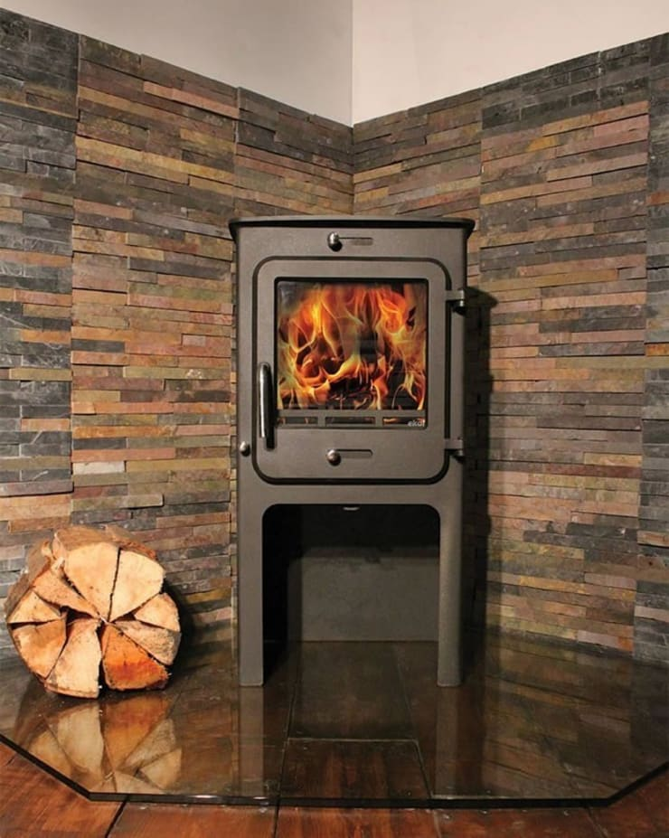 Ekol Clarity High 8kW Wood Burning - Multi Fuel DEFRA Approved Stove:  Living room by Direct Stoves