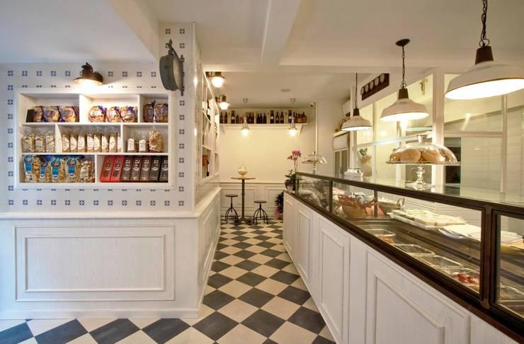 Cibus: il locale B: Gastronomia in stile  di Anomia Studio