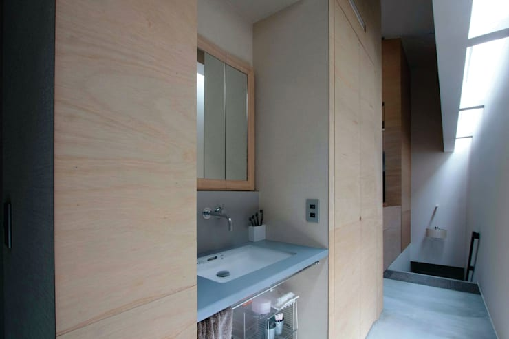 洗面: Kondohideo Architects co,;ltd.が手掛けたキッチンです。