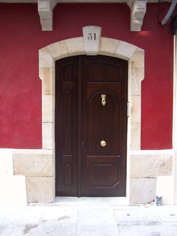 Rehabilitación integral en Plentzia:  de estilo  de ARQUILUR3 S.L.P.