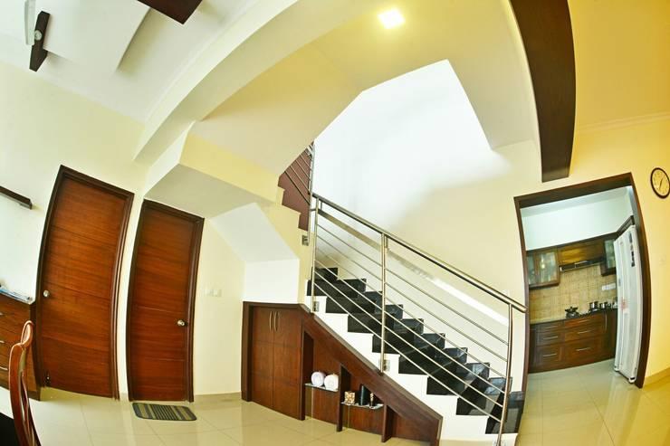 Apartment in Bangalore:  Corridor & hallway by Creative Axis Interiors Pvt. Ltd.