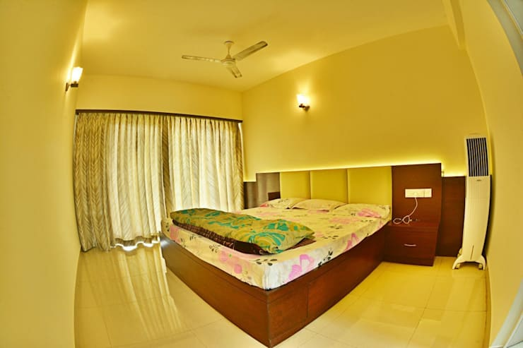 Apartment in Bangalore:  Bedroom by Creative Axis Interiors Pvt. Ltd.