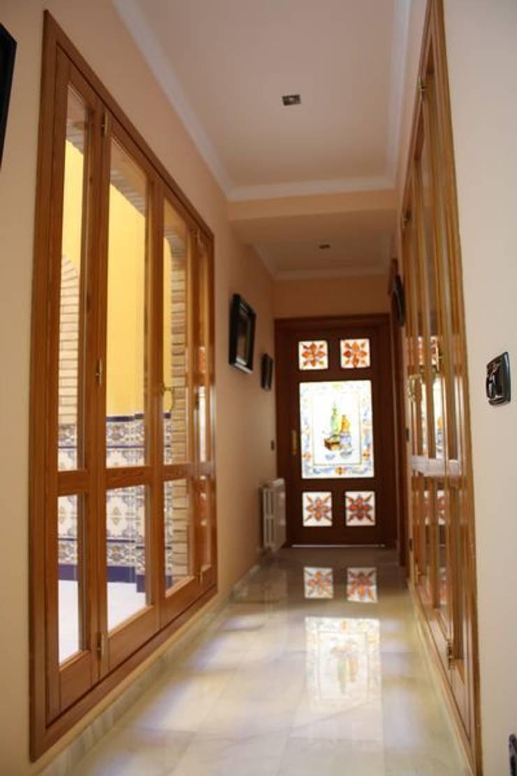 Ventanales de salida a terrazas.: Puertas y ventanas de estilo  de MUDEYBA S.L.