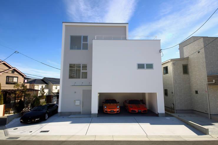 K邸ガレージハウス: 一級建築士事務所・スタジオインデックスが手掛けた家です。,モダン