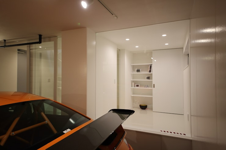 K邸ガレージハウス: 一級建築士事務所・スタジオインデックスが手掛けたガレージです。,モダン