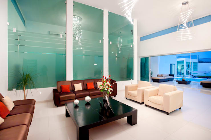 Sala: Salas de estilo  por Arturo Campos Arquitectos