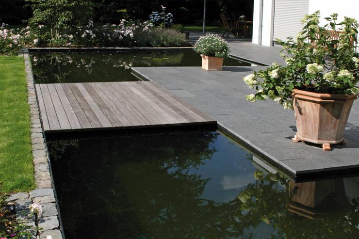 Jardines de estilo  por Grünplanungsbüro Jörg baumann