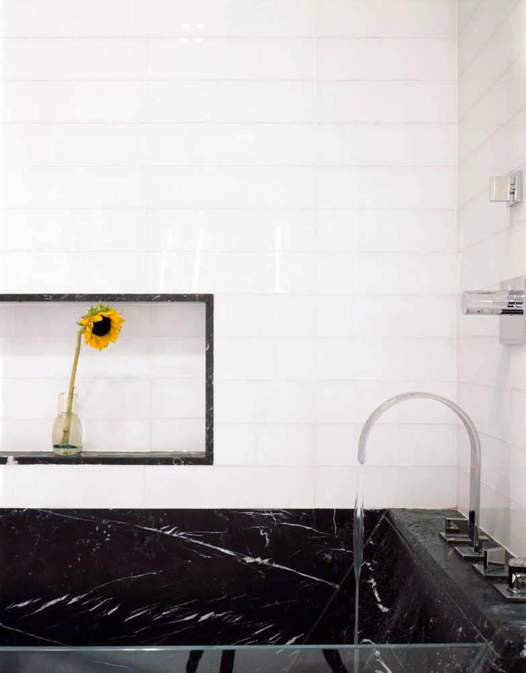 Noho Loft, New York:  Bathroom by studioMDA