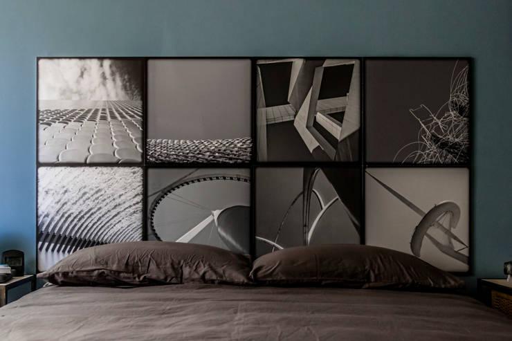 testile: Camera da letto in stile  di cristina leone architetto