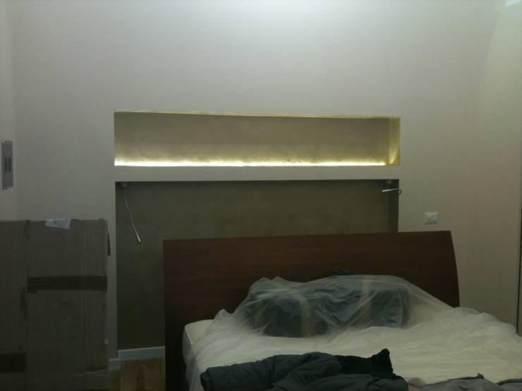 Appartamento Roma Prati: Camera da letto in stile  di piano a