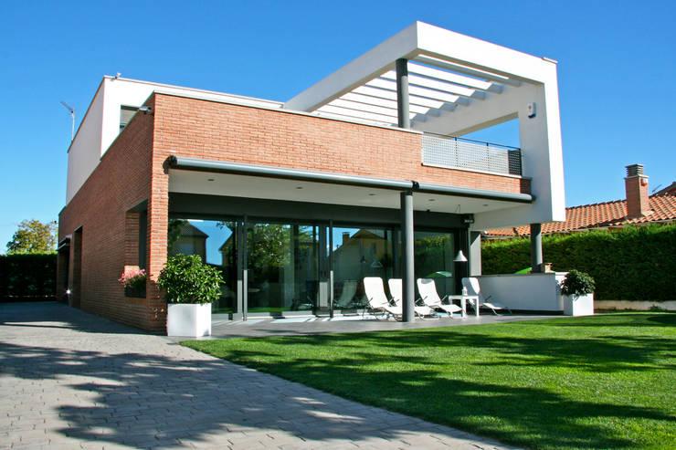 Casas de estilo  por FG ARQUITECTES