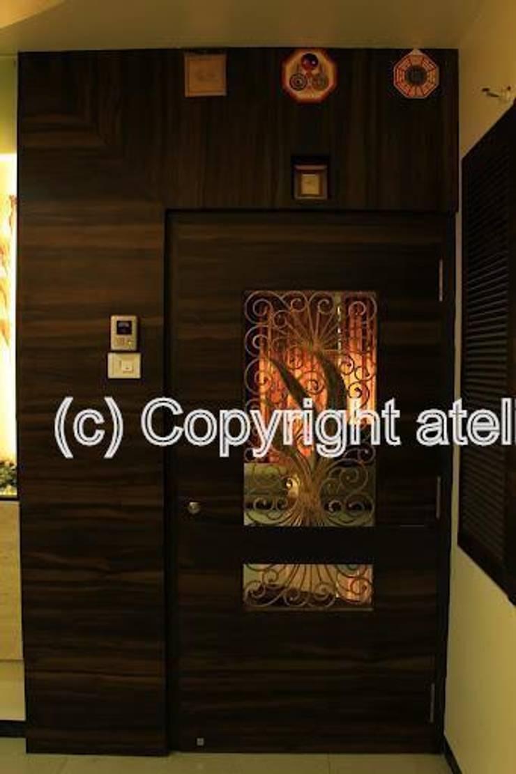 Joiser's:  Corridor & hallway by Ateliers Design Studio