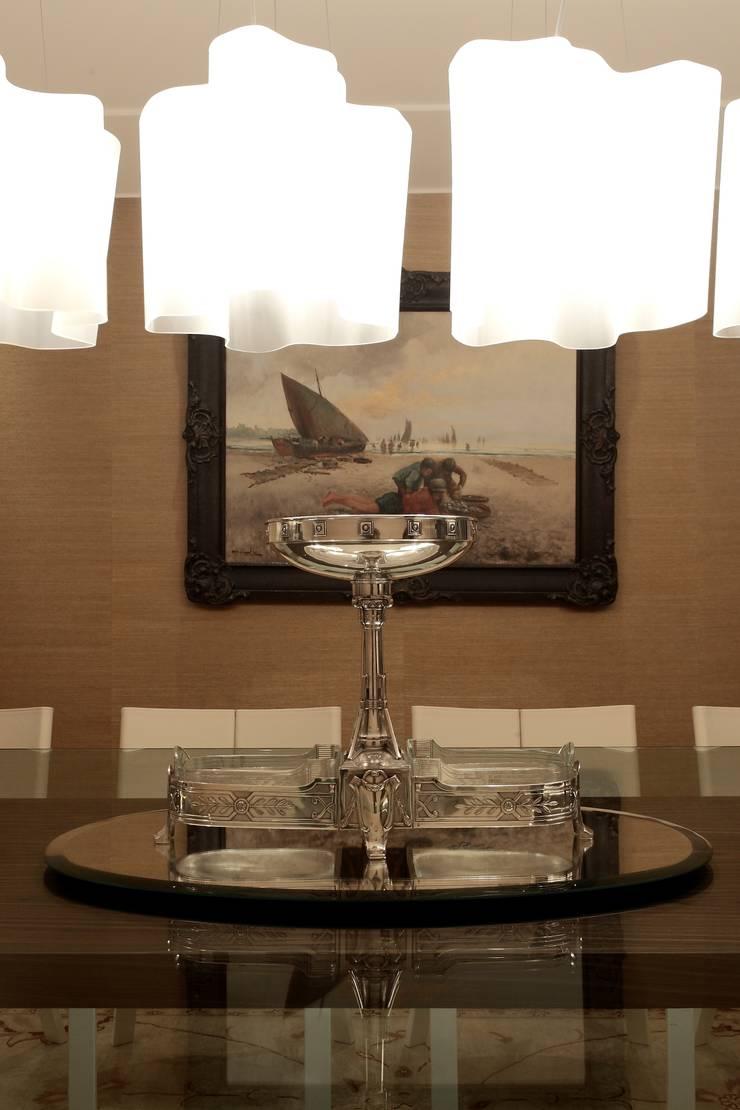 Apartamento Mucuripe: Salas de jantar  por Carlos Otávio Arquitetura e Interiores