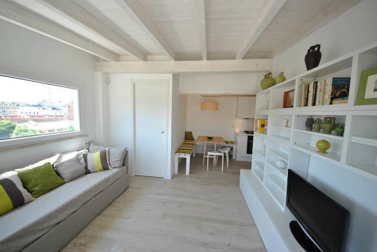 Salones de estilo minimalista de Formaementis