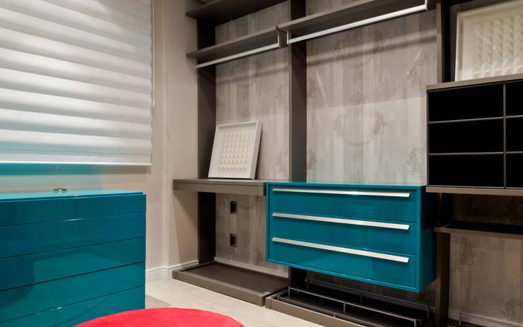 Descanso na cidade: Closets  por ArchDesign STUDIO