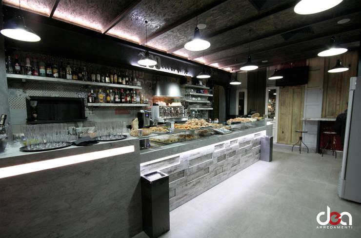 299 loung... bar: Negozi & Locali commerciali in stile  di DEA Arredamenti srl