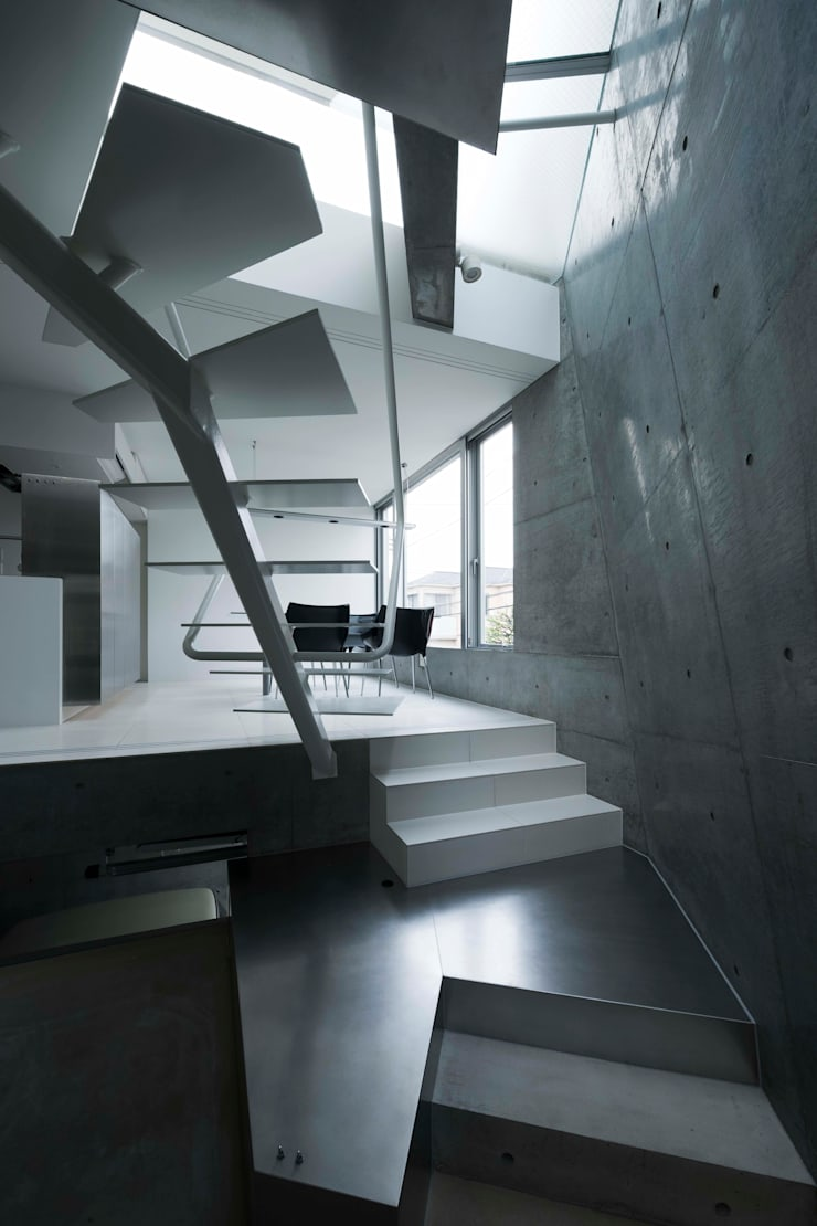 caverna: 筒井紀博空間工房/KIHAKU tsutsui TOPOS studioが手掛けた廊下 & 玄関です。