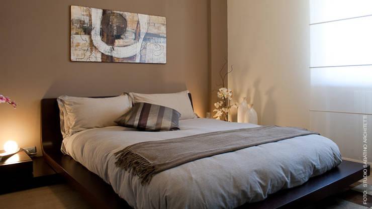 Projekty,  Sypialnia zaprojektowane przez Studio Sabatino Architetto