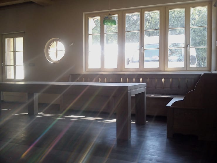 Rénovation d'une ferme en Alsace: Salle à manger de style  par Atelier Laparra
