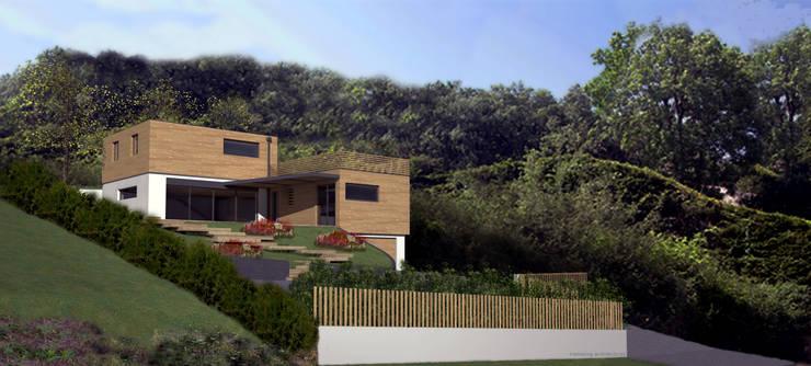 La maison dans son environnement: Maisons de style  par amazing architectures