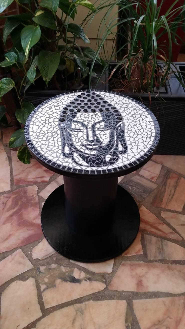 bouddha: Maison de style  par L'atelier
