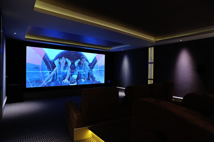 Fabric walling in cinema room:  Media room by Mille Couleurs London