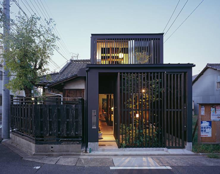 Casas de estilo  por 向井一規建築設計工房