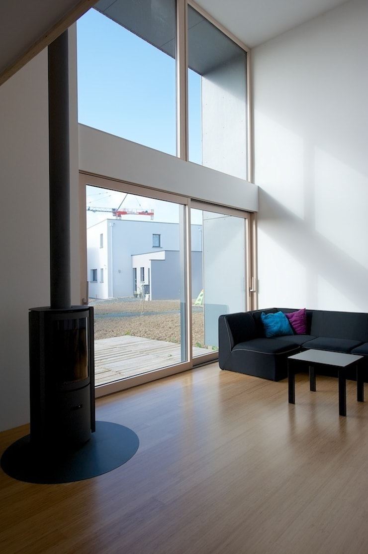 MD12-salon: Salon de style  par Tektolab architectes