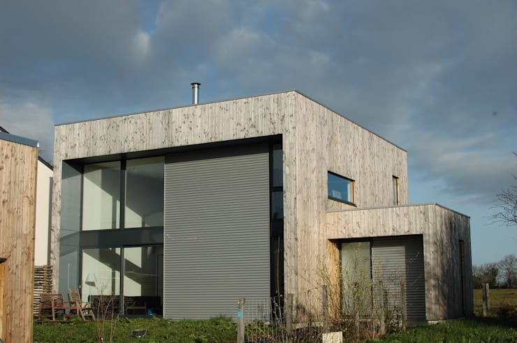 MD12-Façade Sud:  de style  par Tektolab architectes