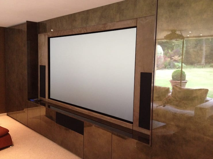 muti purpose cinema room:  Media room by Designer Vision and Sound