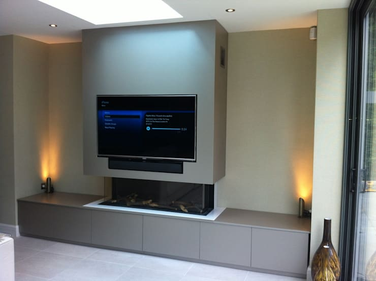 Flush fitting TV and cabinets:  Media room by Designer Vision and Sound