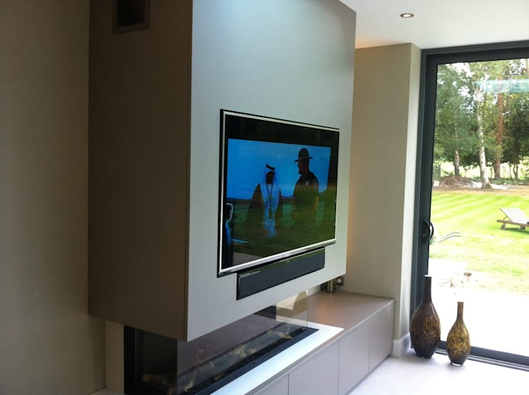 Flush fitting TV and cabinets:  Living room by Designer Vision and Sound
