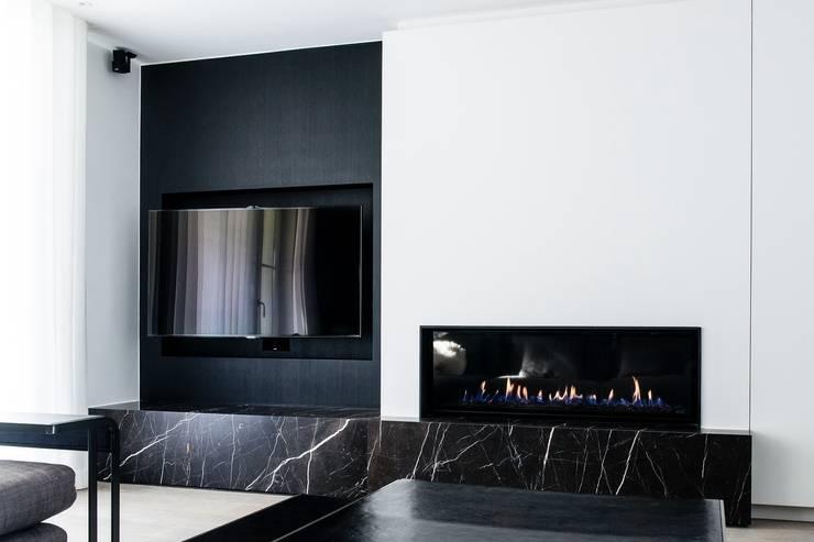Aménagement de A à Z: Salon de style  par Verhelst Interieur
