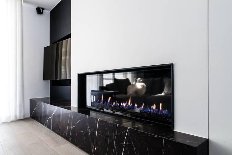 Aménagement de A à Z: Salon de style de style Moderne par Verhelst Interieur