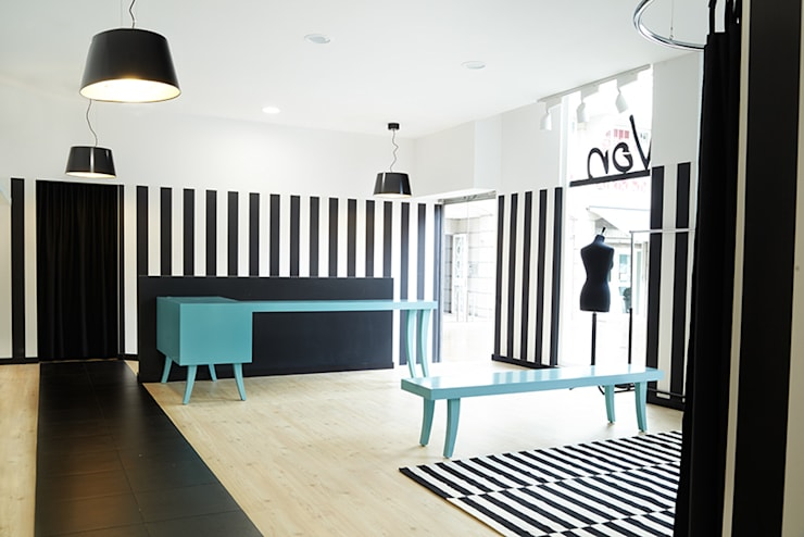 Luci Von. Local comercial para tienda de ropa : Estudios y despachos de estilo  de Estudio de Arquitectura Sra.Farnsworth