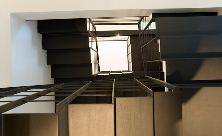 LOFT A MILANO: Case in stile  di BIFFI BONATO CLAUSETTI ARCHITETTI,
