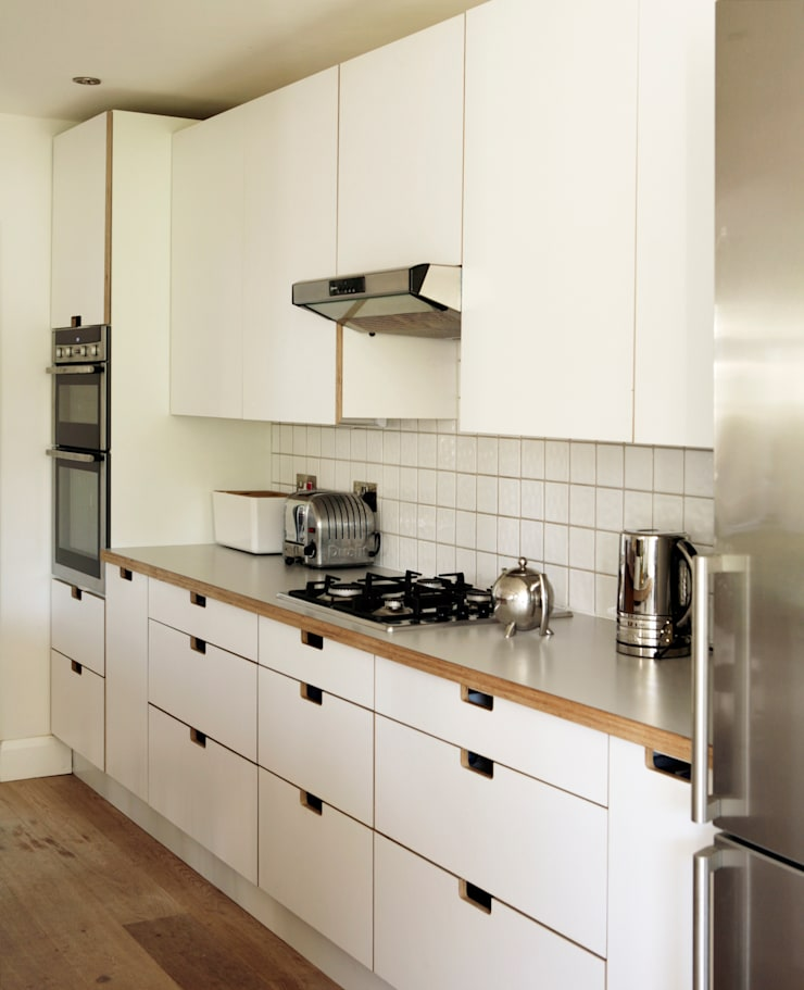 Birch ply and formica drawer and cupboard fronts with 'grab' handles:  Kitchen by Matt Antrobus Design