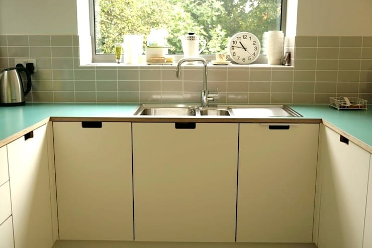 Birch ply and formica cabinet fronts with 'grab' handles:  Kitchen by Matt Antrobus Design