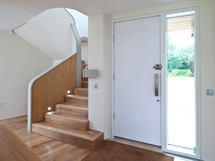 Super Insulated Front Door:  Corridor & hallway by Facit Homes