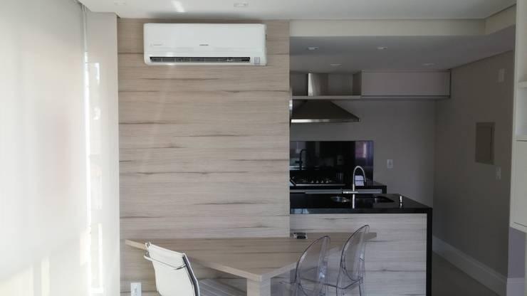 Jantar: Salas de jantar  por Interior Design Christiano Carvalho