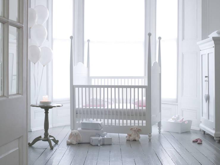 Hestia Cot Bed:  Nursery/kid's room by Custard & Crumble